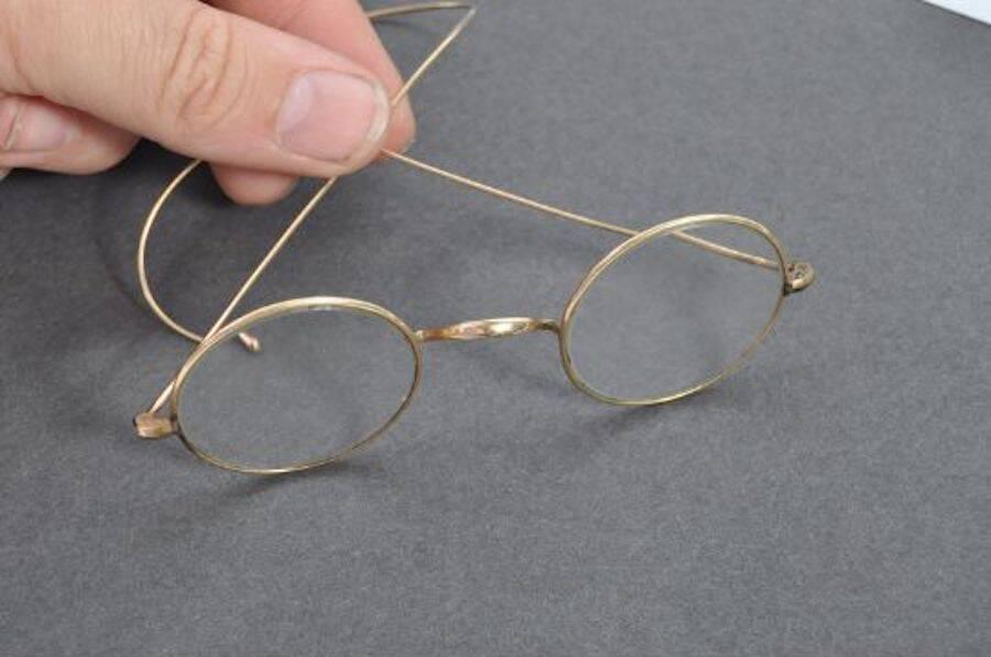 Gandhi Glasses Being Held