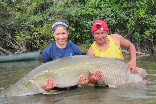 Lesley de Souza And Arapaima Fish