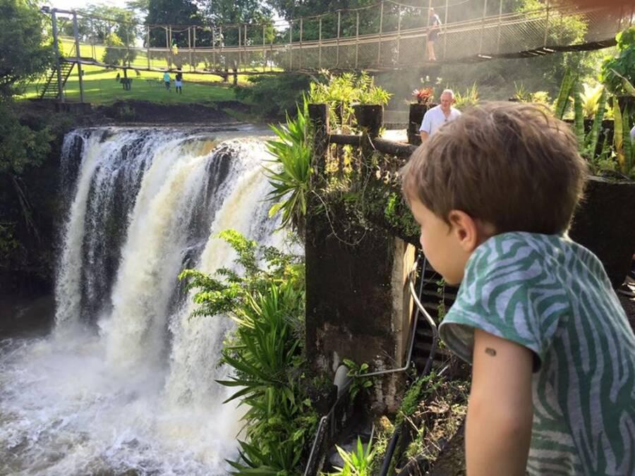 Kid Overlooking Waterfall