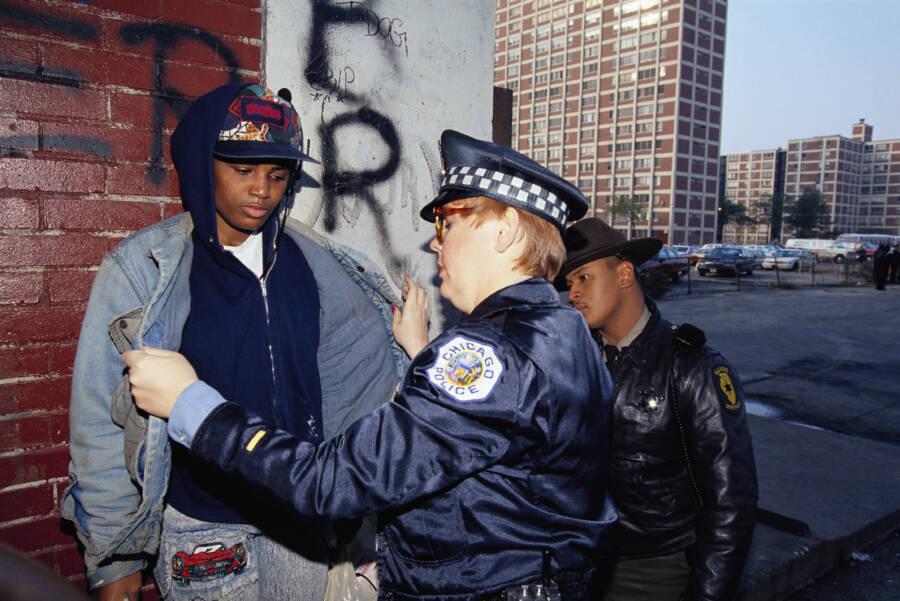 Police Searching A Teenage Boy
