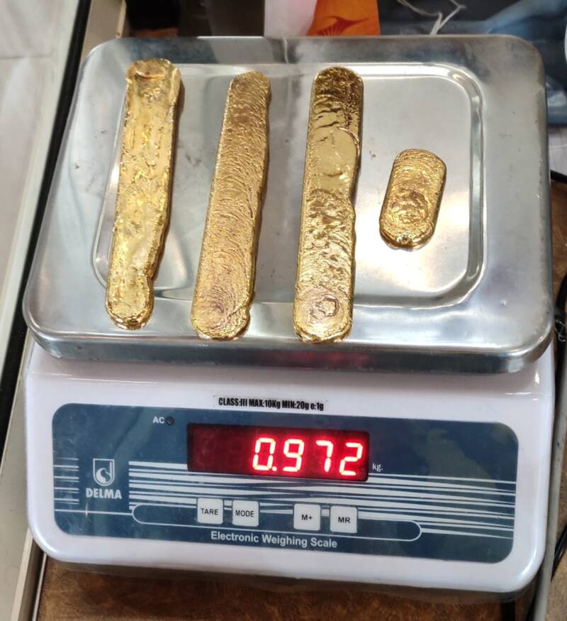 Gold Being Weighed