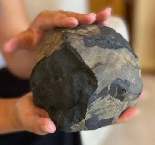 Holding Meteorite