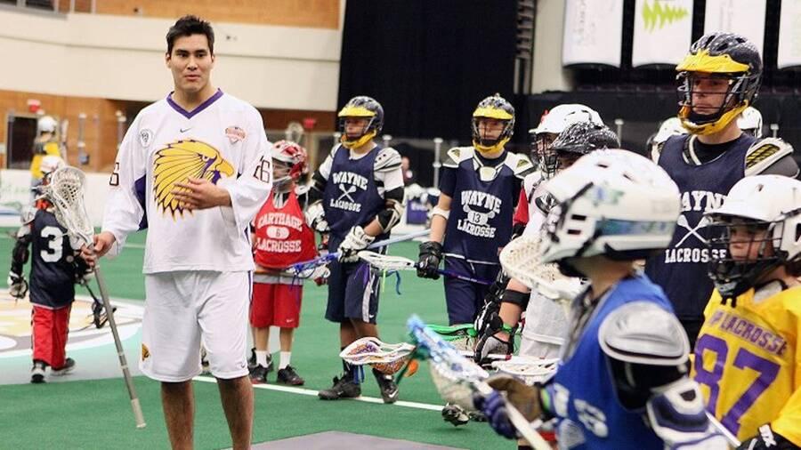 Iroquois Lacrosse Player Teaching Kids