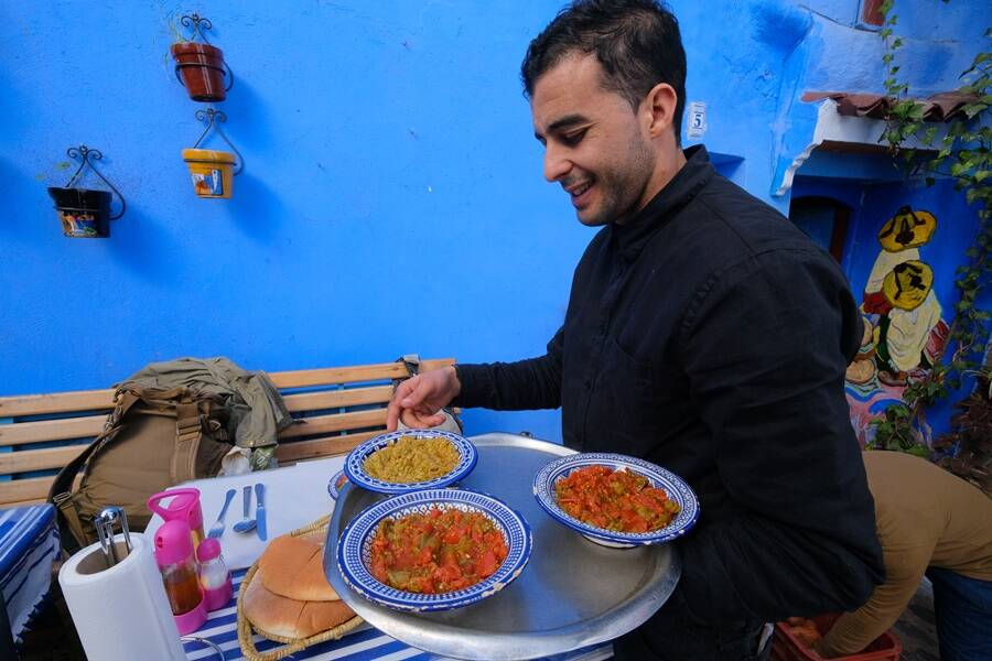 Man Serving Moroccan Food