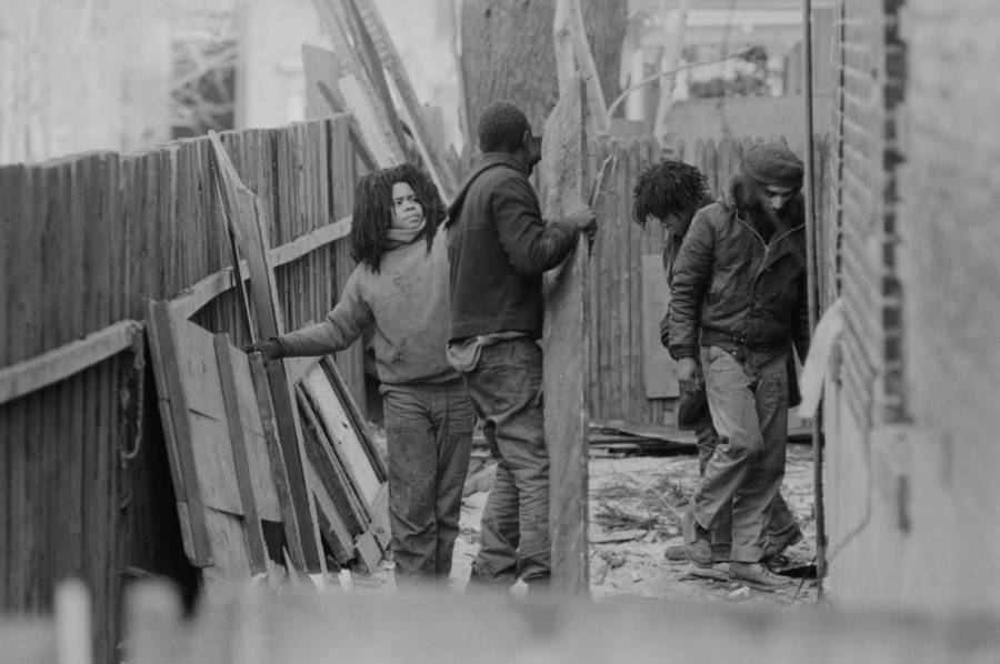 Move Members Boarding Up A House
