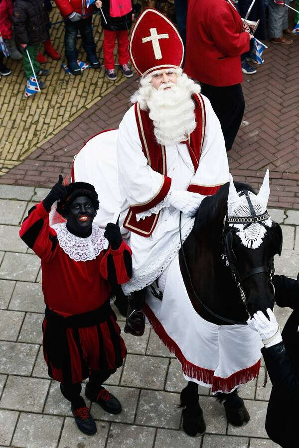 Black Pete And Sinterklaas On Horse