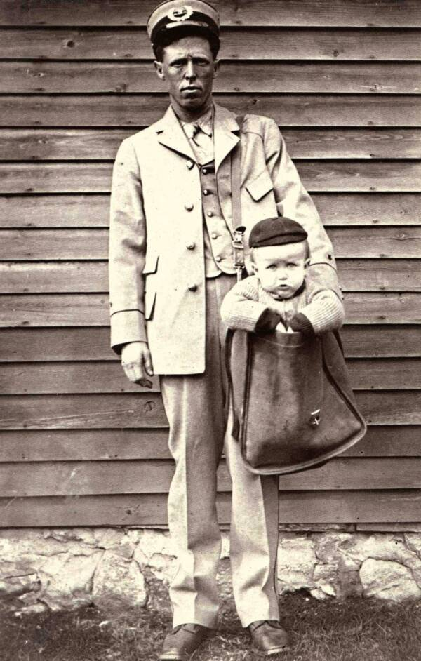 Weird Historical Photo Of A Mailman Delivering A Child