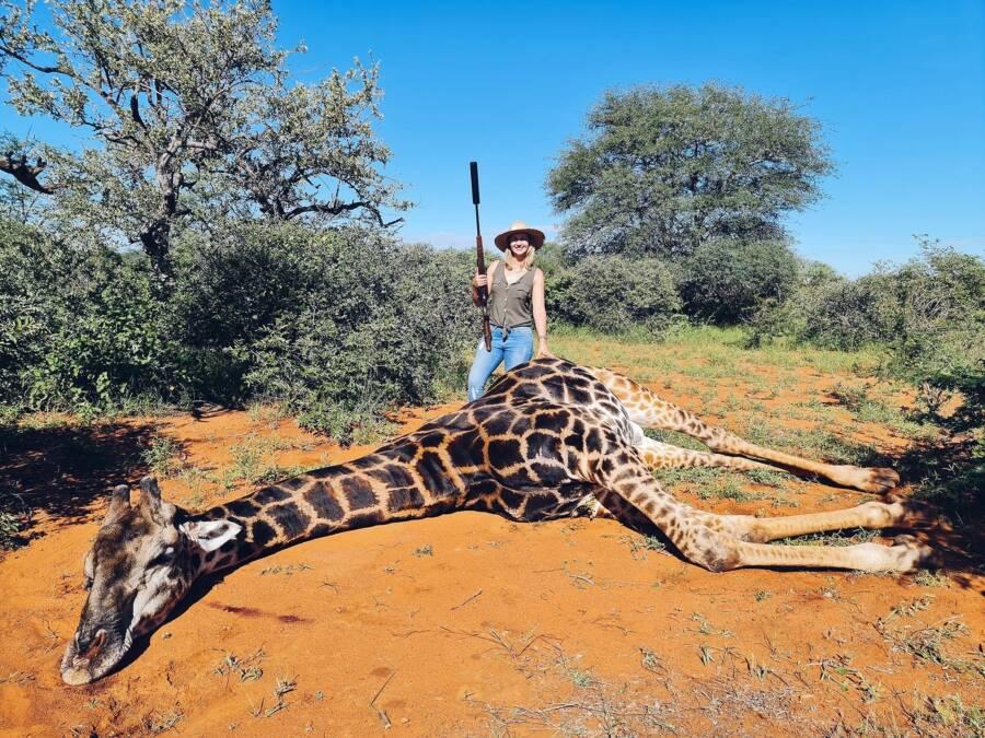 Merelize Van Der Merwe With Rifle And Giraffe