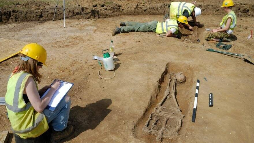 Archeologists At Roman Burial Site
