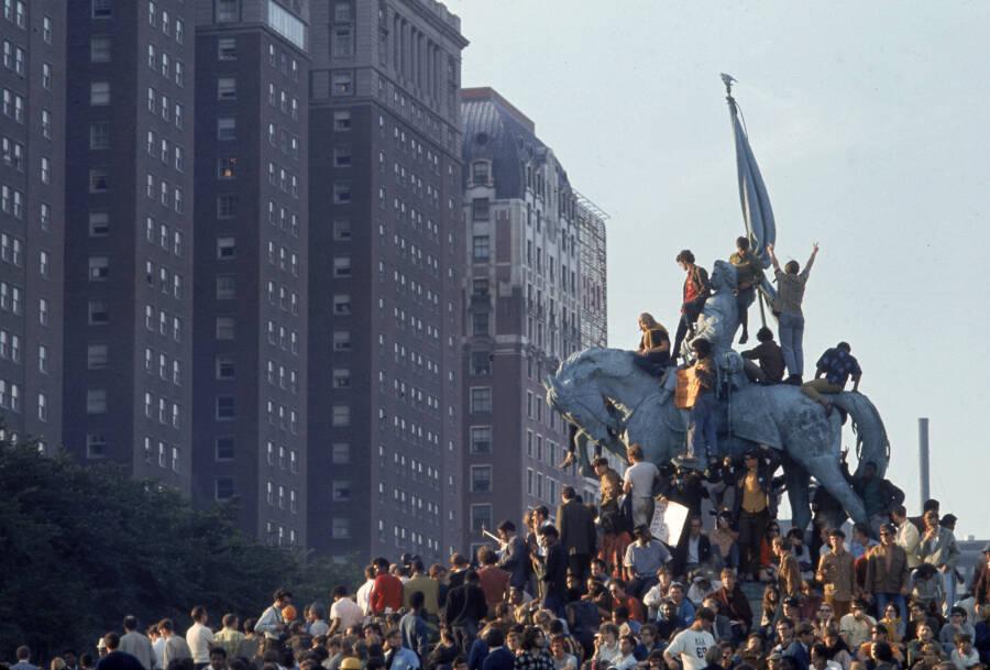 Demonstrators On Statue In Grant Park