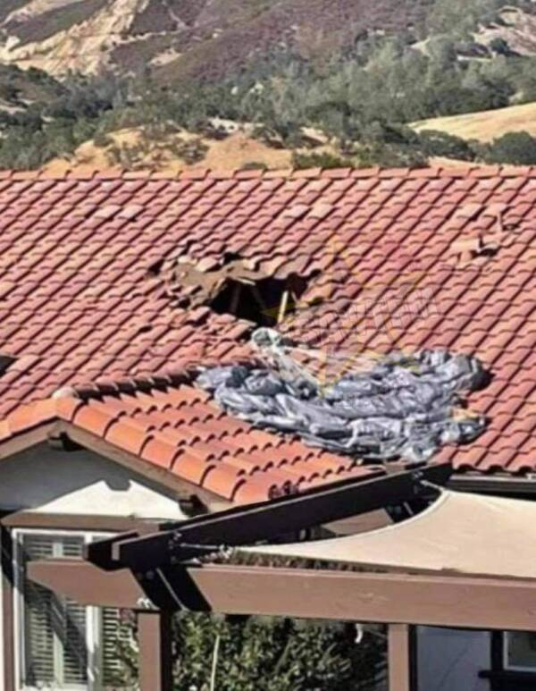 Twitter/TheWTFNation Miraculously, the soldier crashed straight through the attic trusses — but left a sizable hole in the roof.