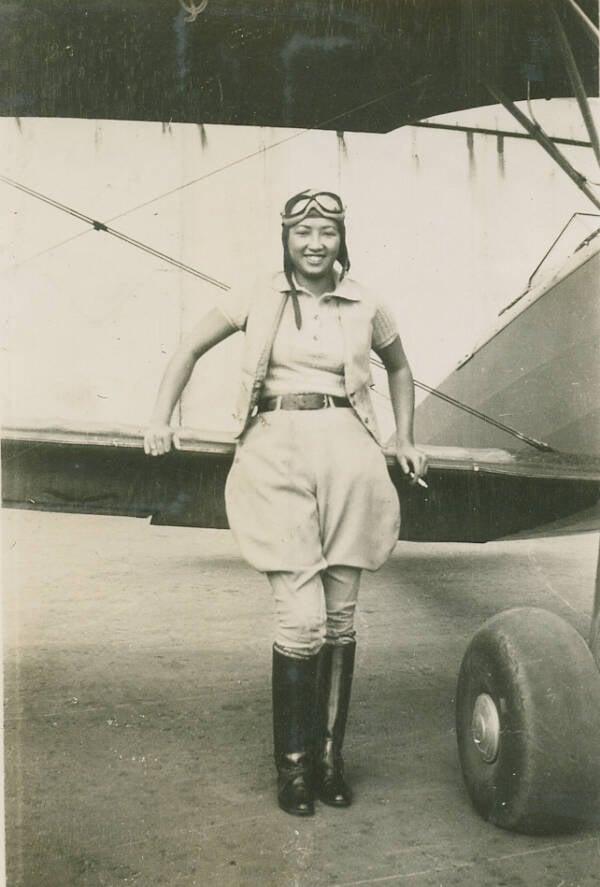 Hazel Lee Posing With Her Plane