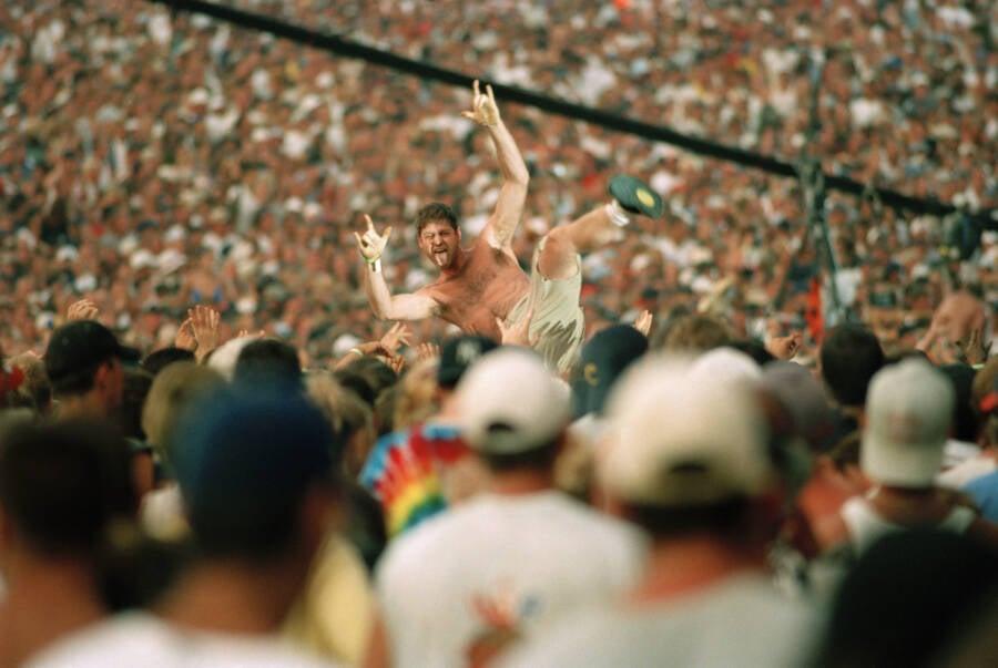 Cheering Fan Crowd Surfing At Woodstock 99