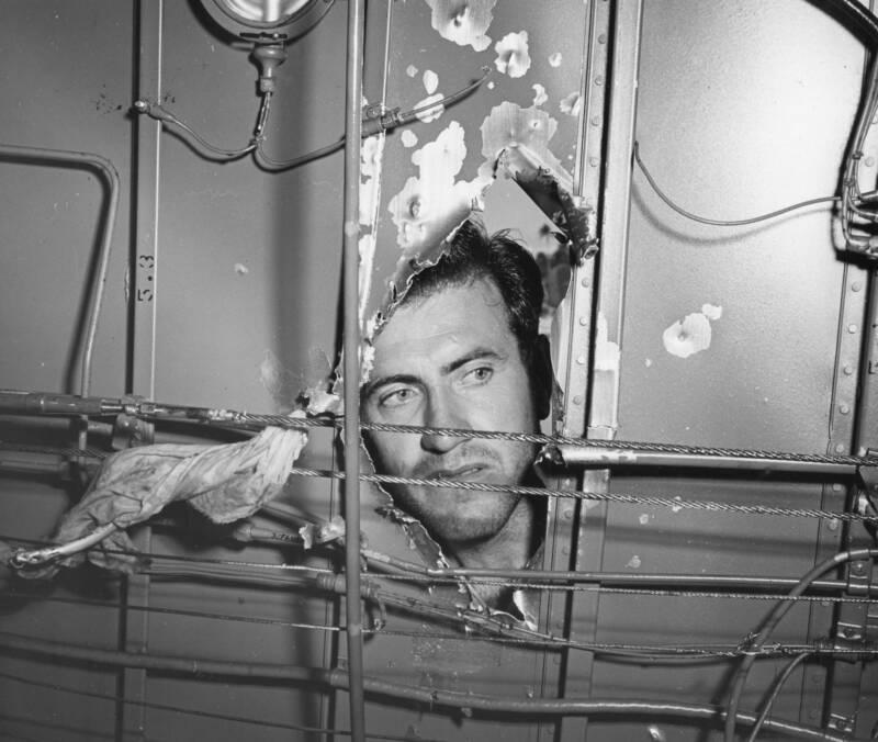 Louis Zamperini Inspecting Airplane Damage