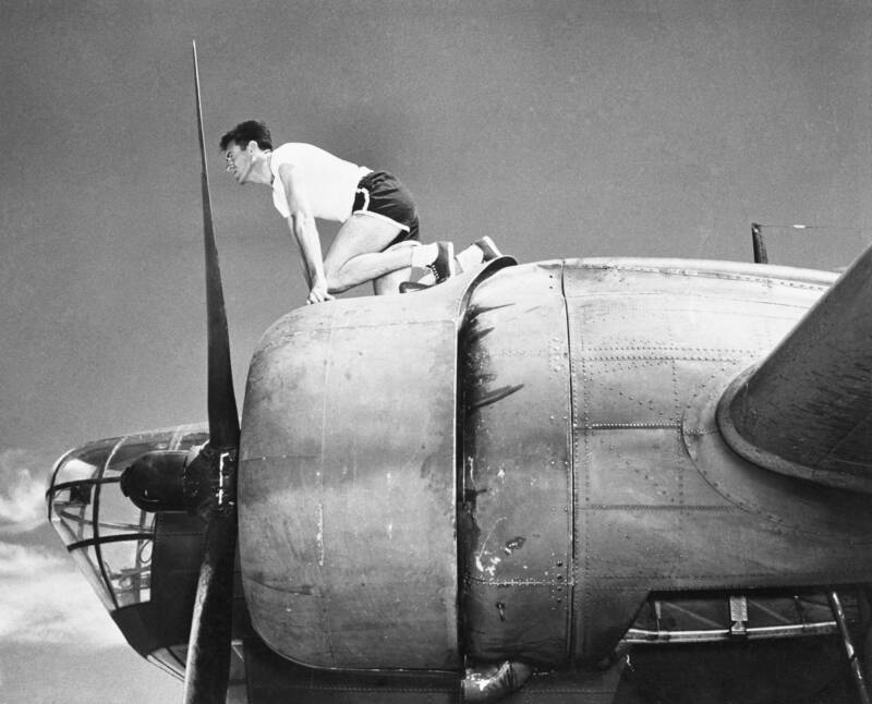 Louis Zamperini Perched On A Bomber