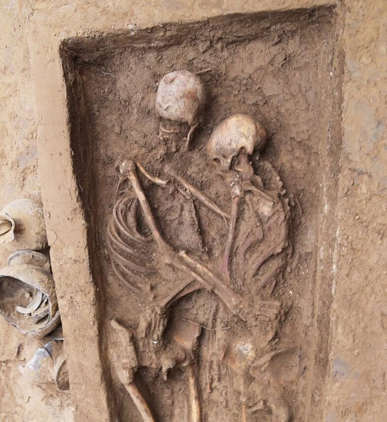 Lovers Embracing In Their Grave