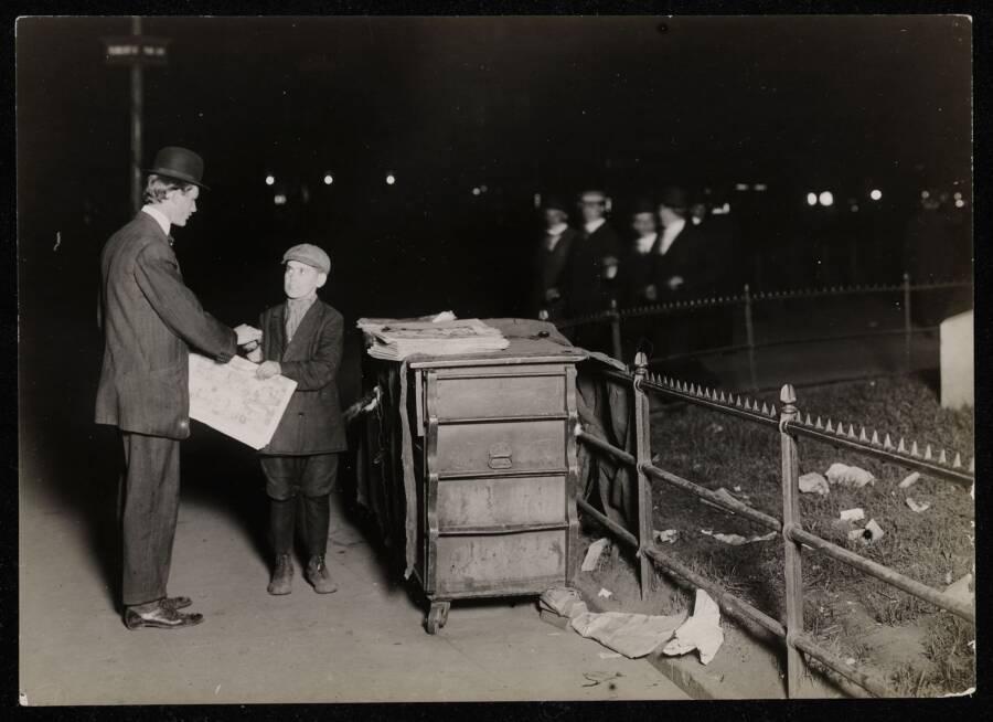 Young Newsboy At Night